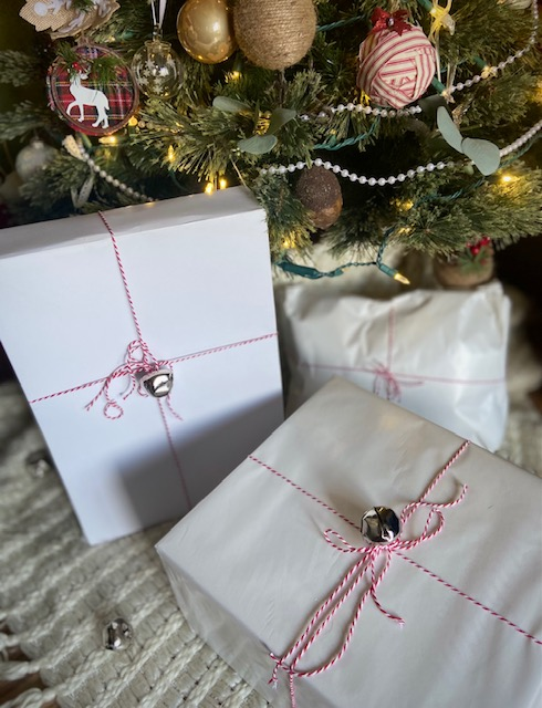 white packages tied with string