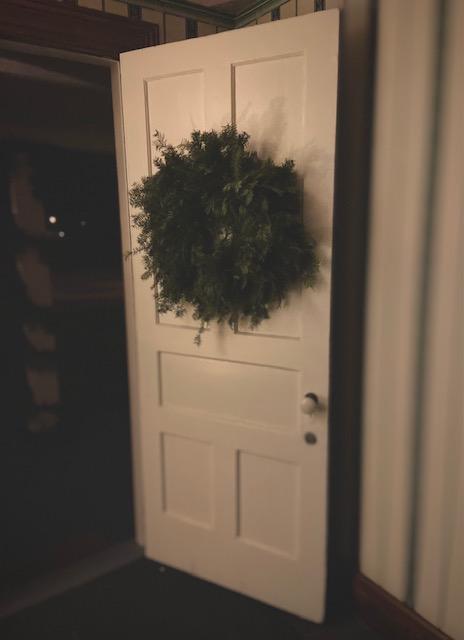 wreath on white door
