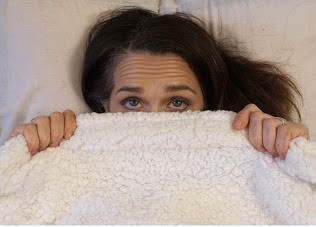 woman in bed trying to get more sleep