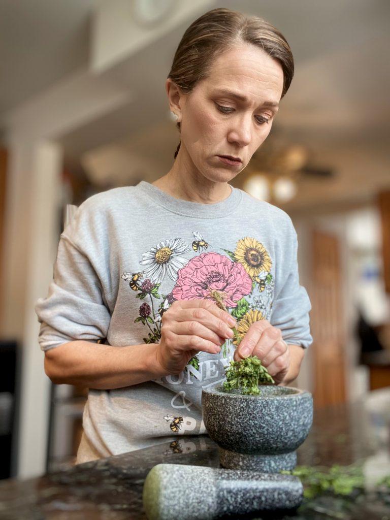 woman drying Fresh Herbs from Garden