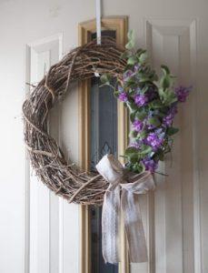 natural spring wreath hanging on the door