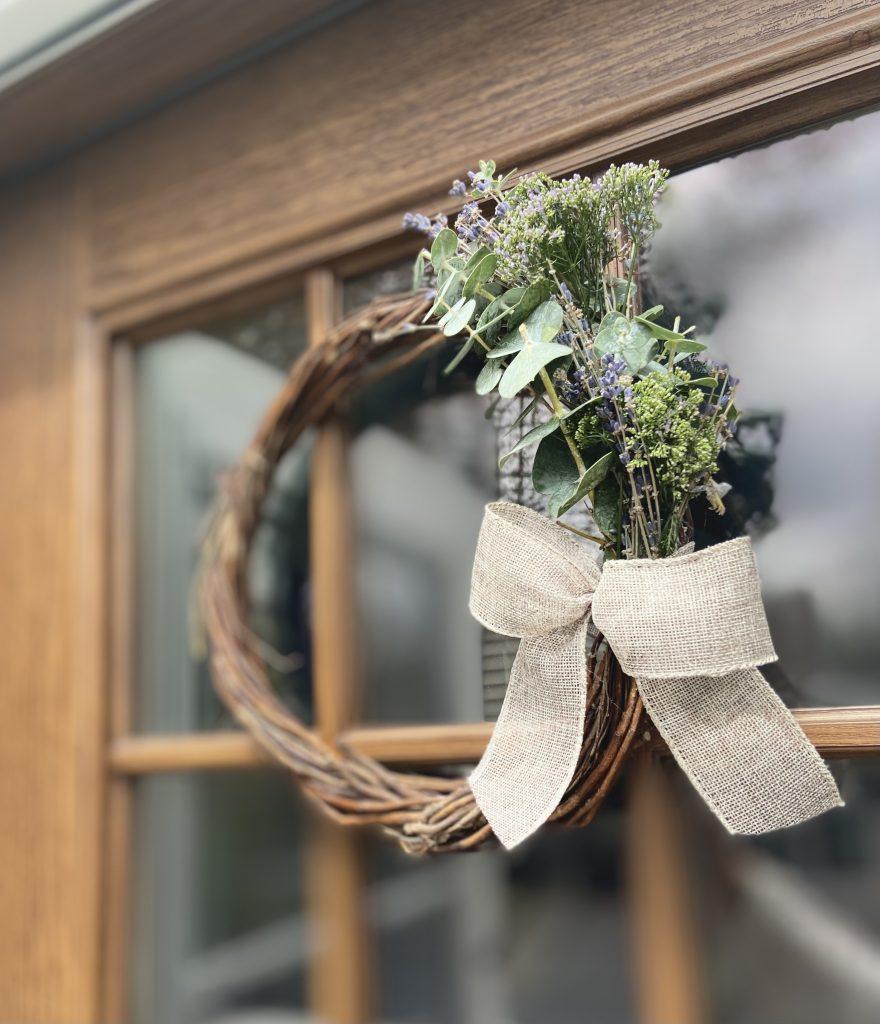 homemade spring wreath on door