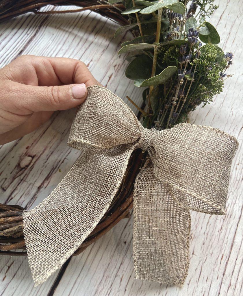 burlap bow on a farmhouse wreath
