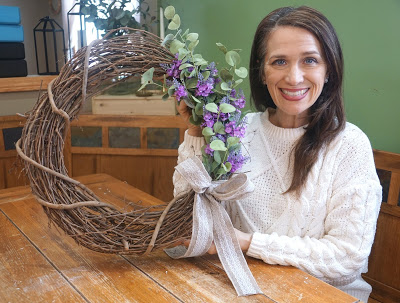 woman holding a natural spring wreath
