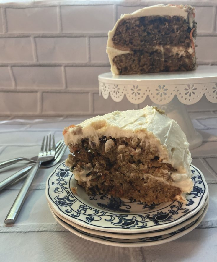 slice of sourdough carrot cake on pretty blue dishes