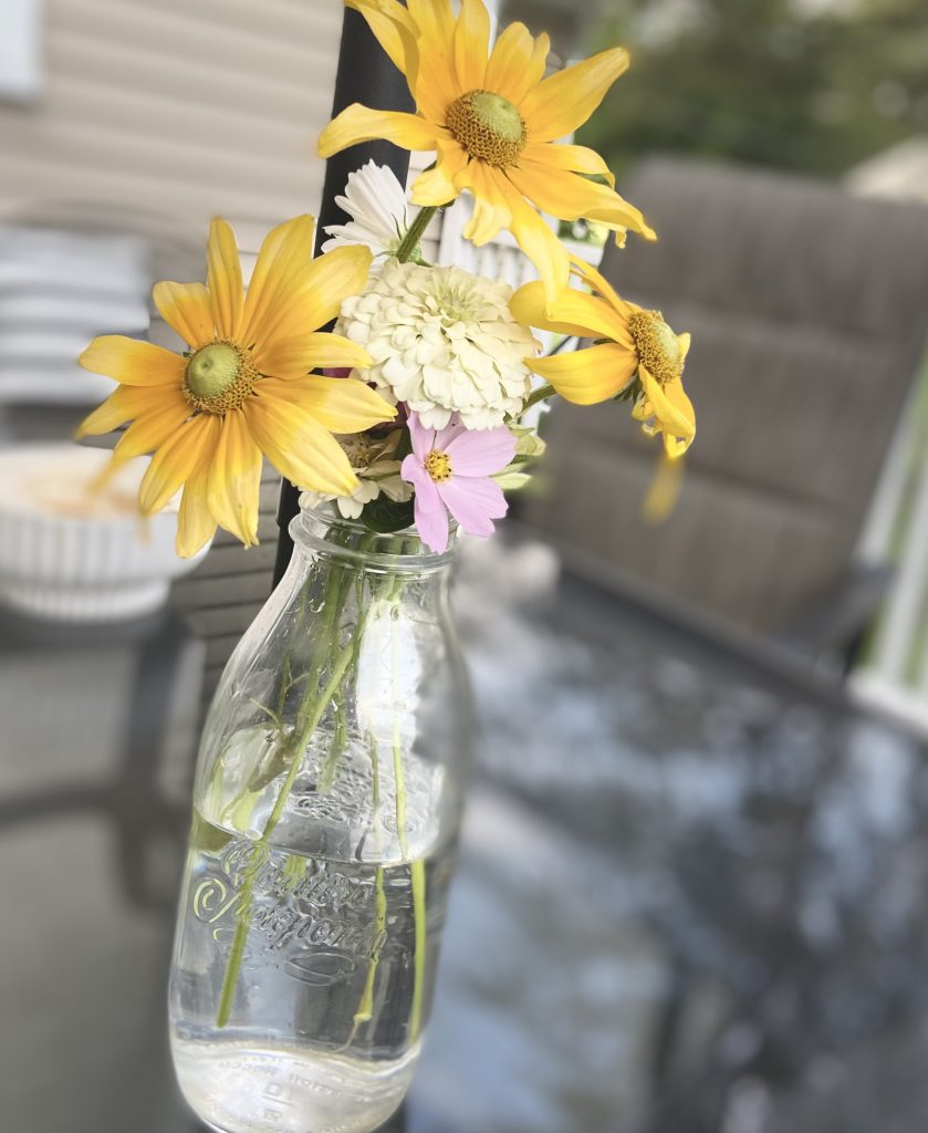 fresh flowers in a milk jug
