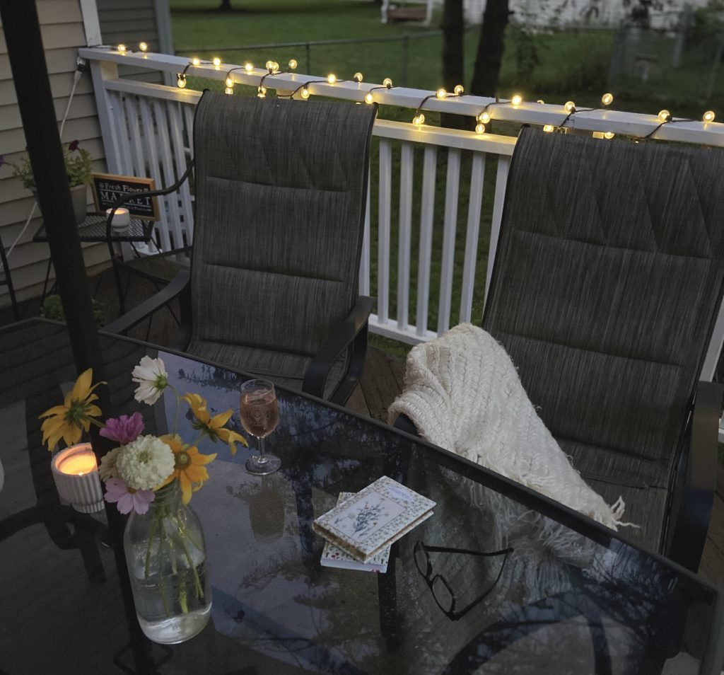 nighttime on  a cozy back deck