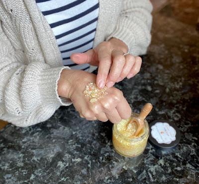 Woman using Fall Epsom Salt Body Scrub using Essential Oils